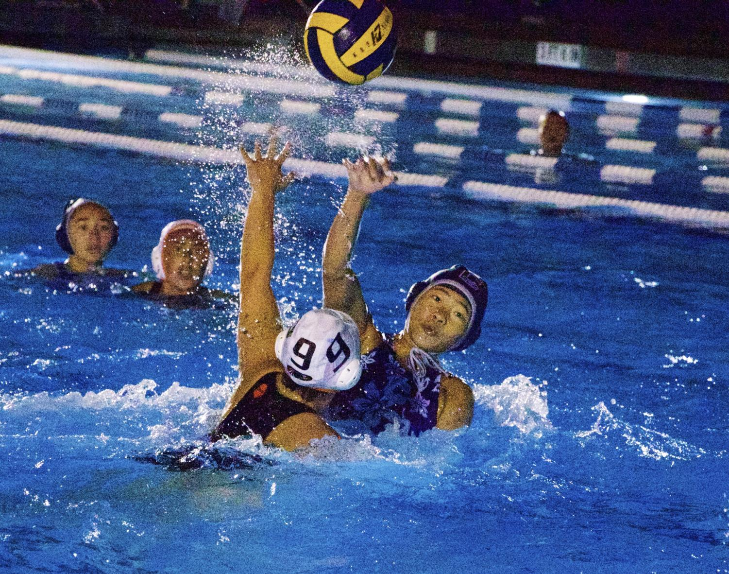 Sophomore Maya Lee finds  an open teammate to pass the ball to.