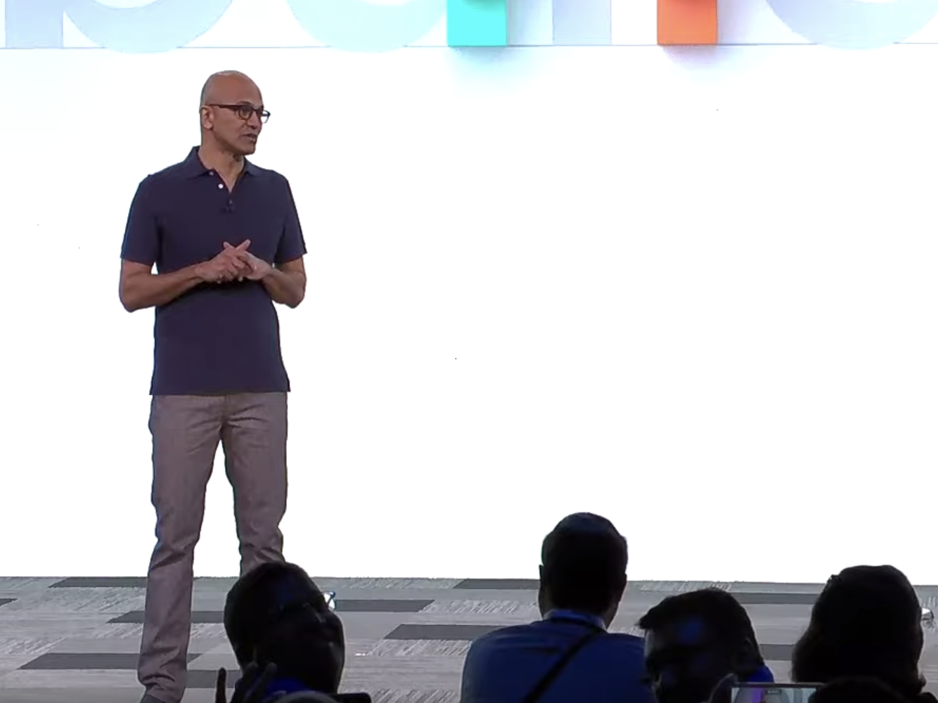 Microsoft CEO Satya Nadella presenting at the company's annual developer conference, Build 2019. Here, he announced several new open software projects with partners. Nadella hopes developers can be involved in Microsoft's open-source efforts.