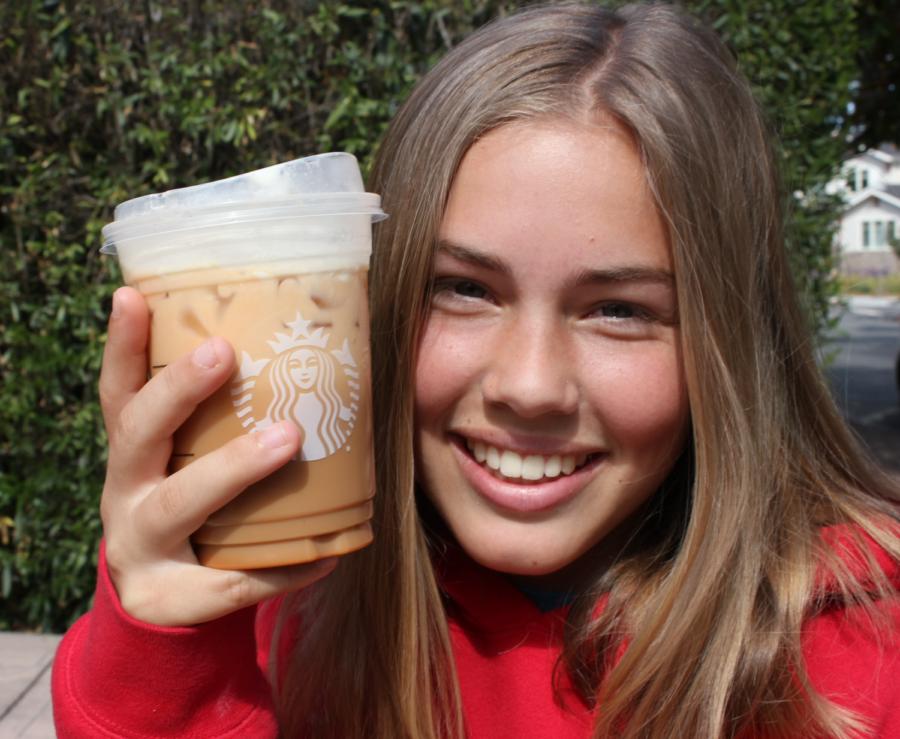 Anna+Kolpakova+enjoys+an+iced+pumpkin+spice+latte+on+the+first+day+of+fall.+