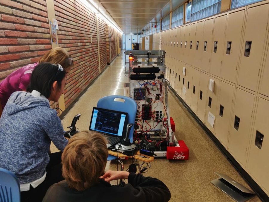 Two+students+and+a+mentor+work+on+the+robot%27s++autonomous+capabilities.