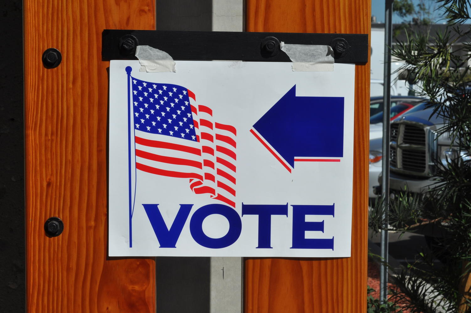 A sign points to a nearby polling place in California. The Voter's Choice Act makes it easier for voters to cast their ballots.