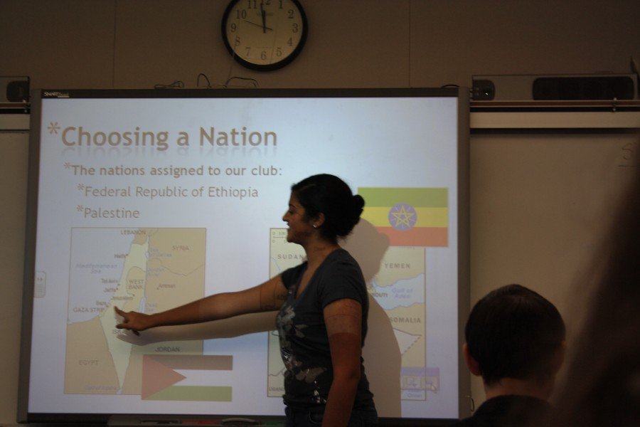 Deepti Bansal, president of the Model UN club, presenting her powerpoint to members.