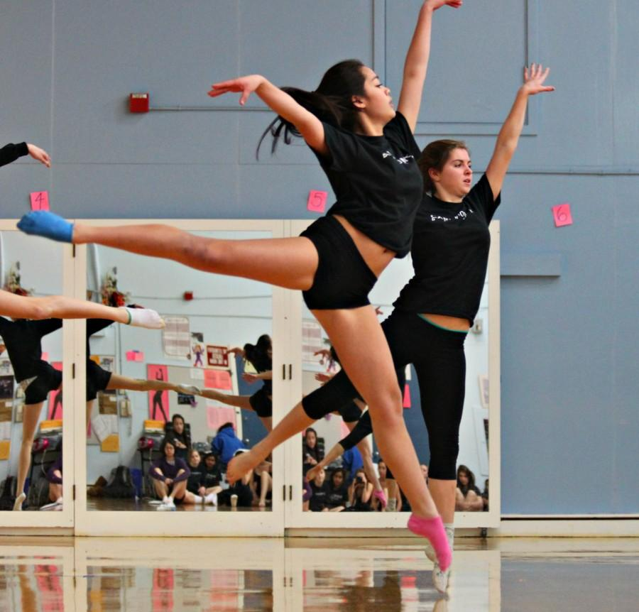 Sophomore Charley Bernardo shares a piece of her choreography with the help of another dancer