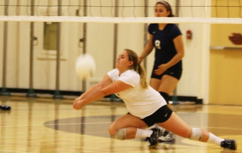 Libero, Ashley Duba dives to save the ball