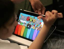 Disabled child using iPad