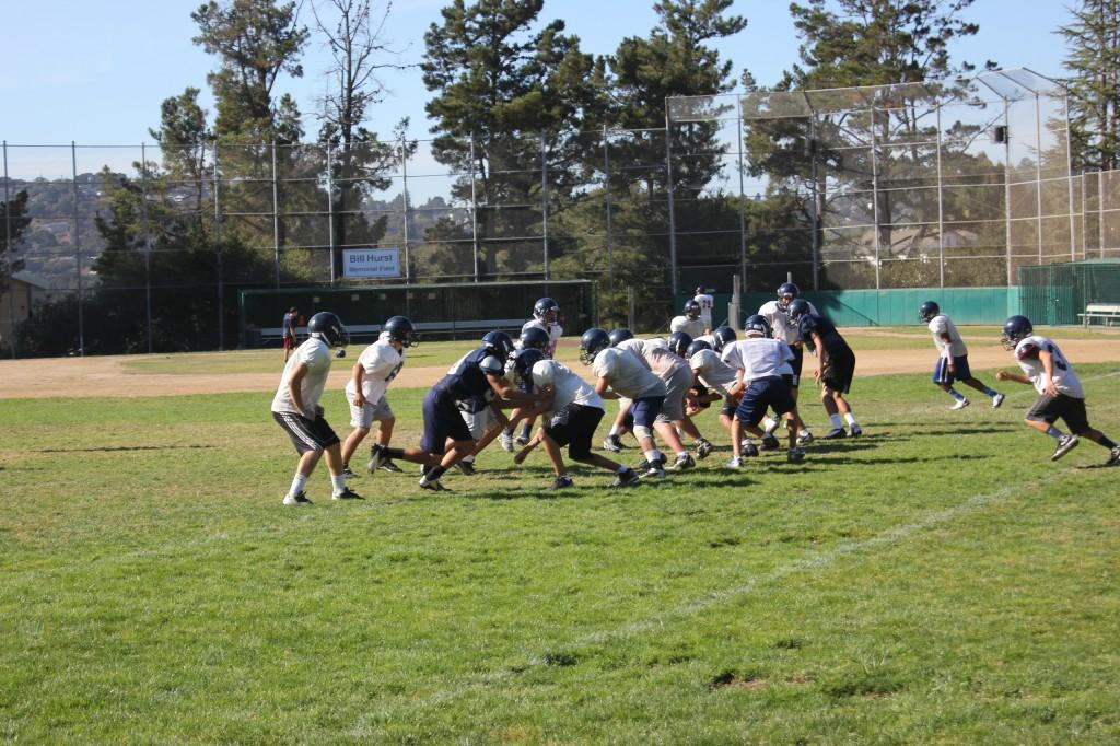 The Junior Varsity football team practices on the baseball fields.