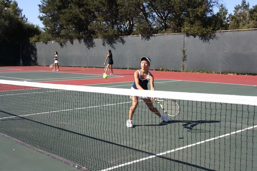 Sydney Cho warms up before playing Burlingame.