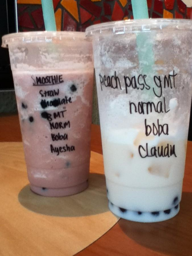 A strawberry chocolate smoothie with boba and the very popular peach passion milk tea with green tea and boba.