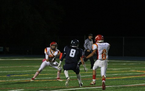 Matt Stalun (8) in pursuit of wrapping up a Mills receiver