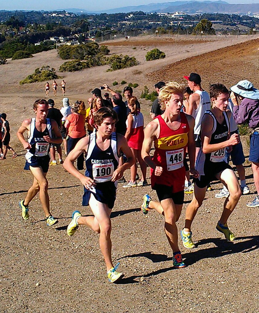 Juniors Ryan Dimick, left, and James Schulte, far right, next to a Mills runner