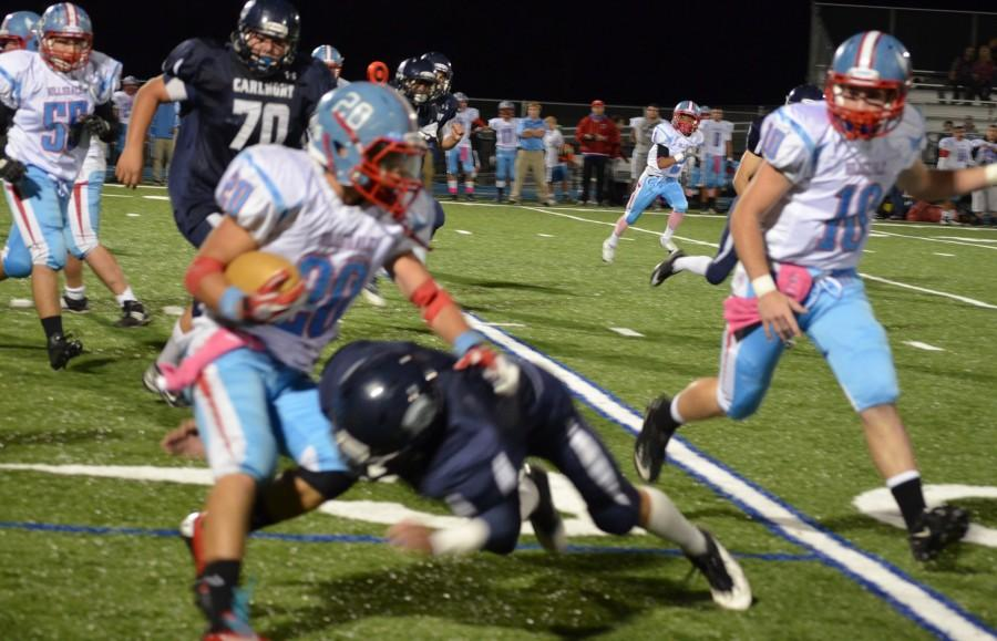 Alex Paiz (left) tries to avoid a tackler