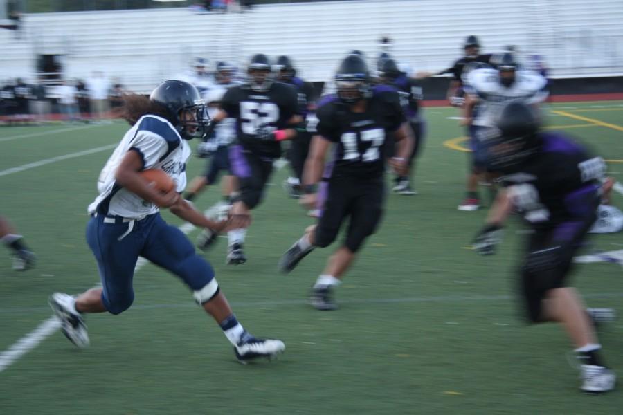 Willie Teo runs against the Sequoia defense.