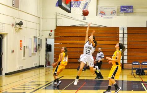 Varsity girls basketball wins first game of the season