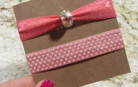 Pink soft elastic hair ties, one with polka dot print