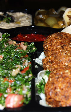falafel, tabbouli, hummus, olives, and vegetable appetizer
