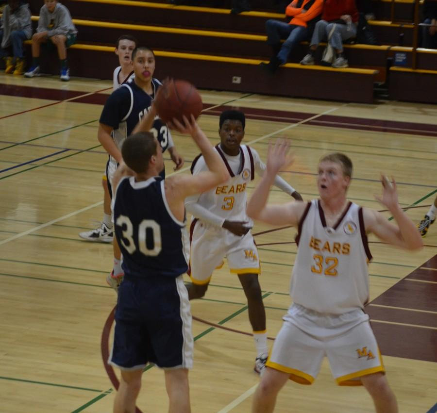 Costello shoots over a Menlo-Atherton defender