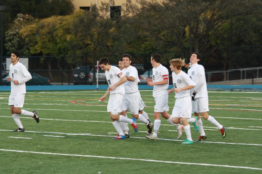 The scots celebrate after Ryan Freeman scores the fifth goal of an eventual 8-0 win.