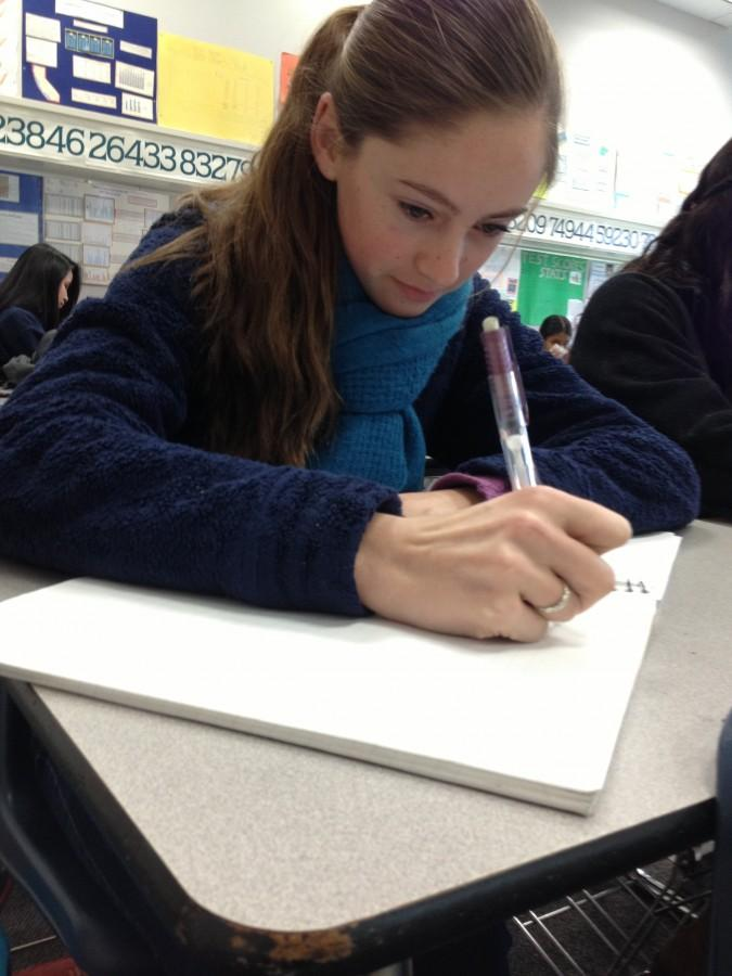 Kaitlyn Kelly taking notes in class