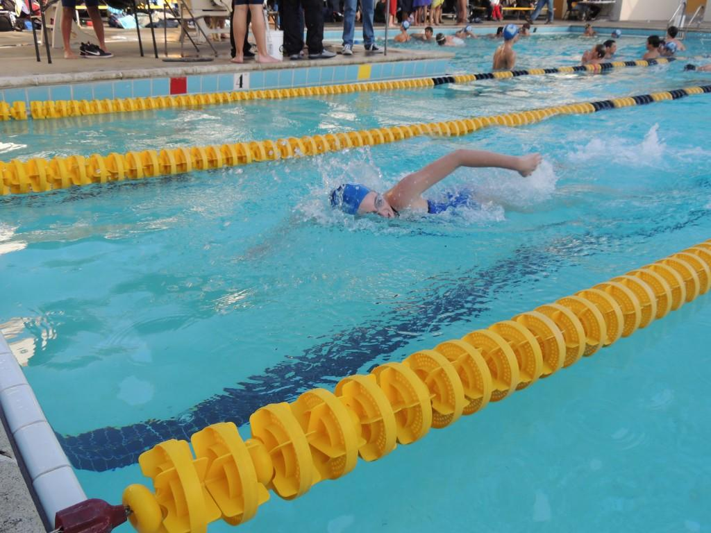 Carlmont sophomore swimmer Sam King reaches for the wall during a race.