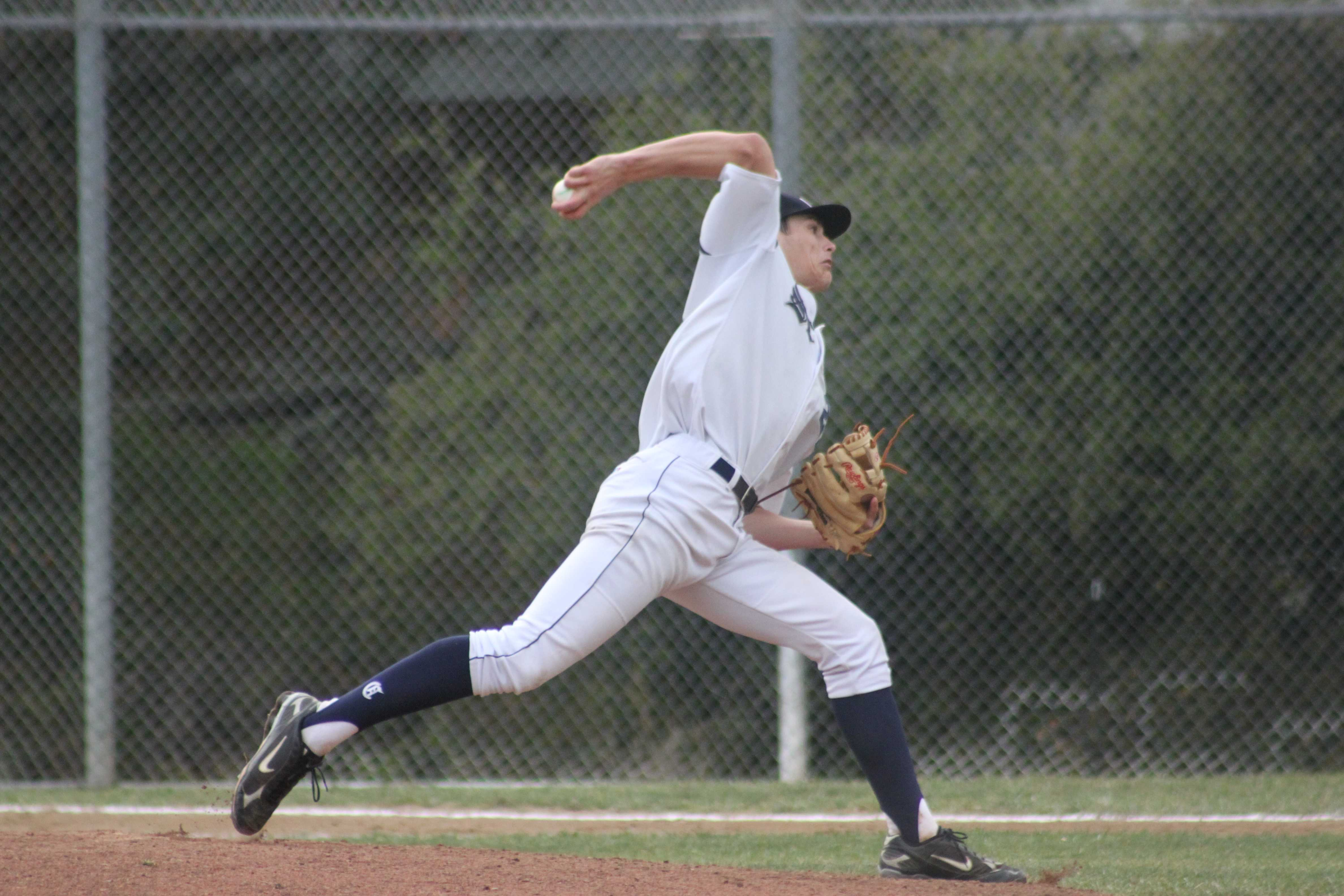 Senior Greg Hubbell pitching against the Cougars