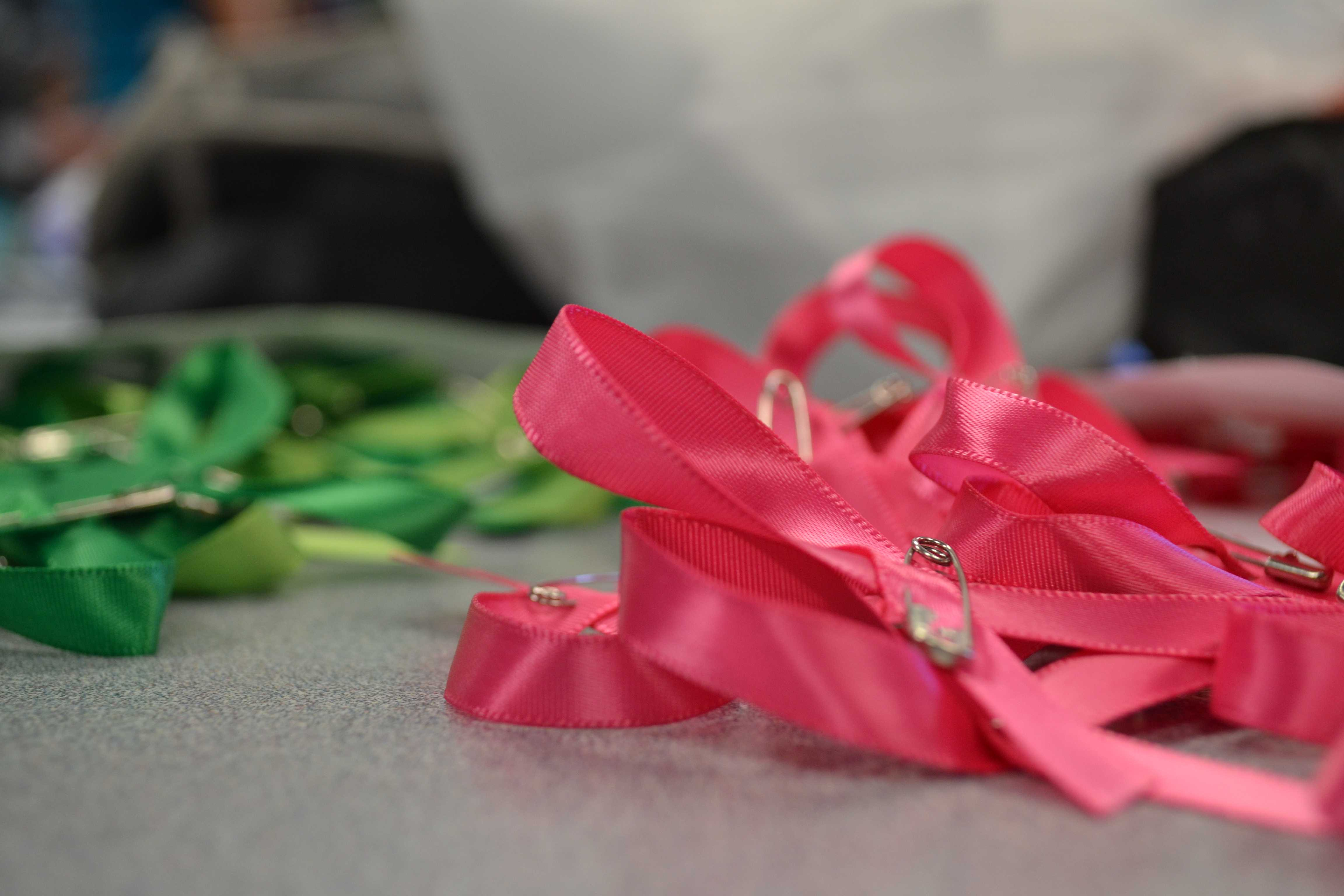 The pink ribbons for cancer will be handed out on Monday to promote awareness.
