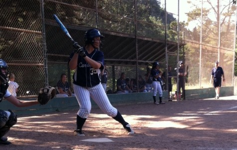 Loucks braces herself at bat for the oncoming pitch