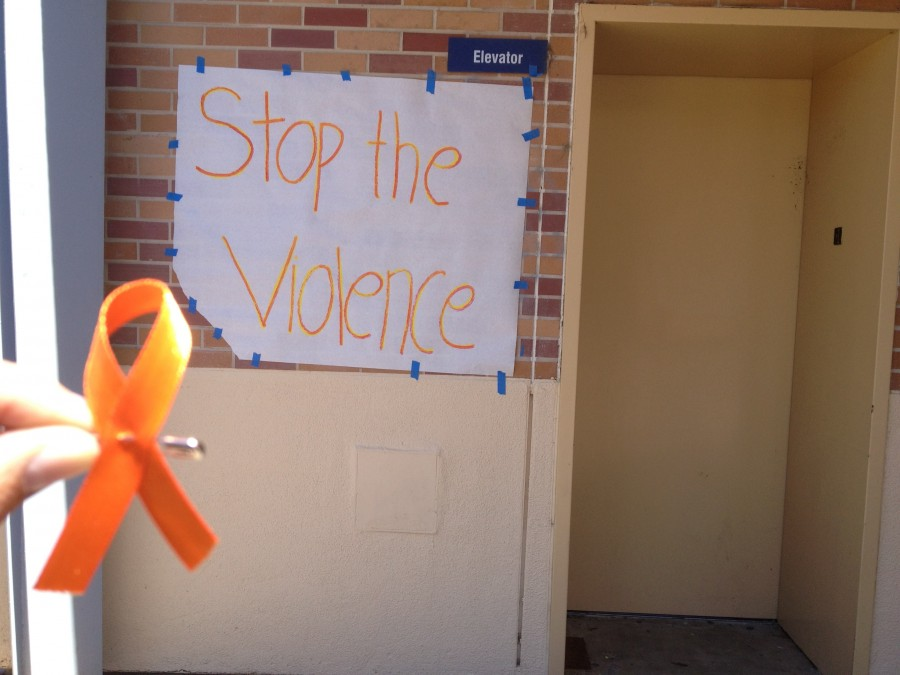 Posters+were+hung+up+and+orange+ribbons+were+passed+out+to+support+the+ending+of+violence.