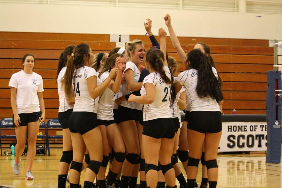The Lady Scots celebrate their victory.