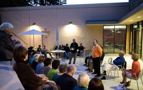 Candidate Eric Reed explains the necessity of an engaged community in the amphitheater of the Belmont Library.