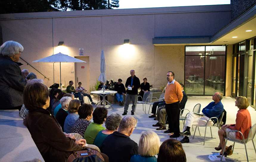 Candidate+Eric+Reed+explains+the+necessity+of+an+engaged+community+in+the+amphitheater+of+the+Belmont+Library.