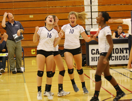 Erin Alonso, Natalie Tussy, Kellan McDonough, and Alexis Morrow jump for joy after their win