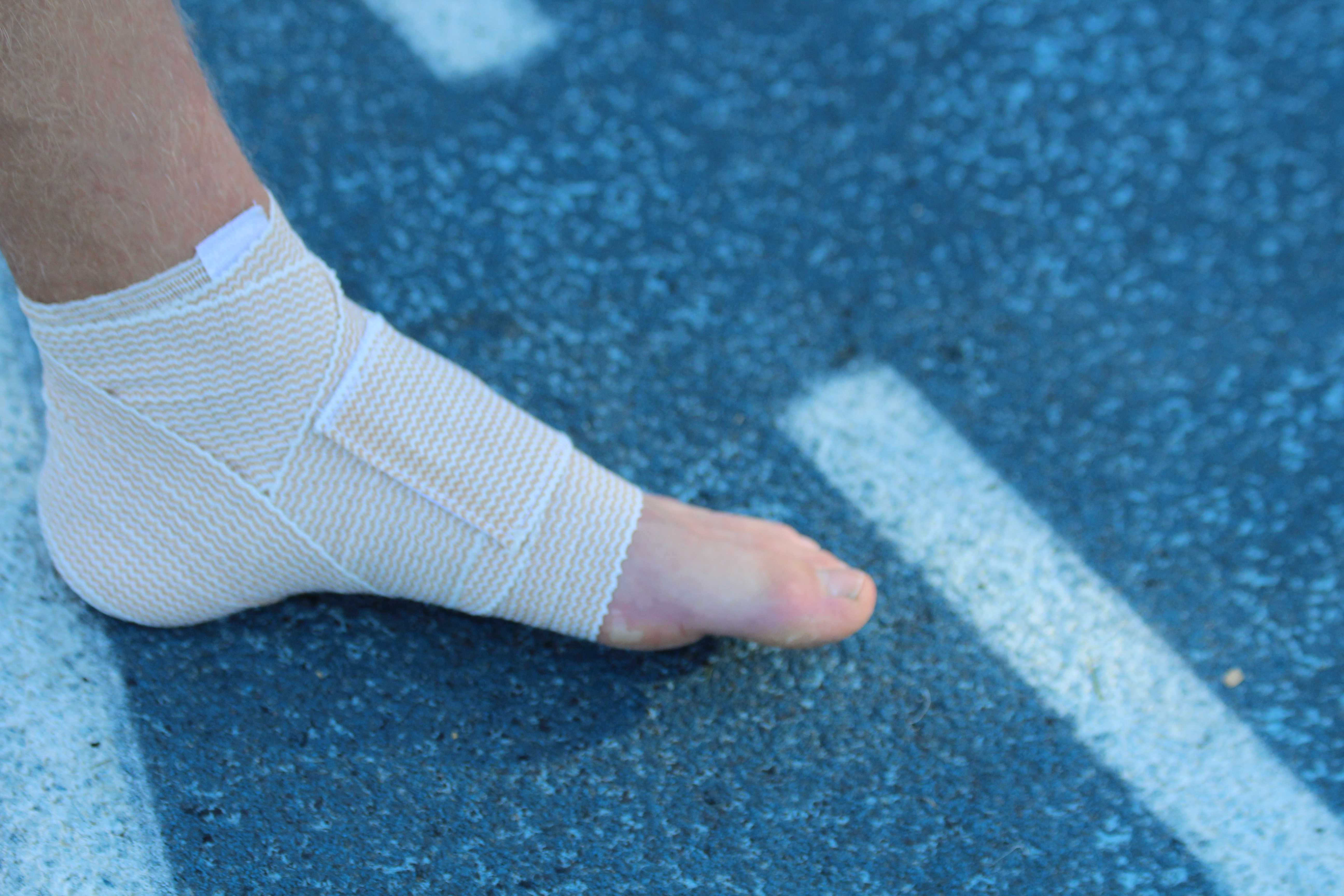 Boys Varsity Cross Country Runner Franklin Rice twisted his ankle, injuring it further by continuing to run on it.