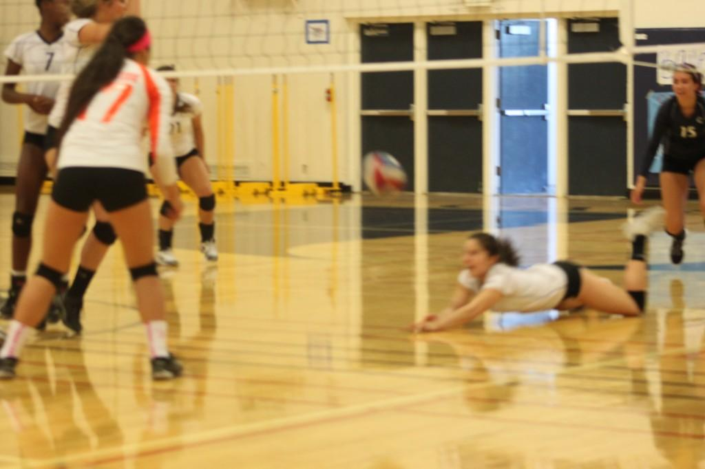 Sophomore Erin Alonso dives for the ball.