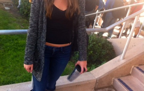 Junior Vinka Radich in her comfy, grey open-knit sweater, paired with boots and jeans