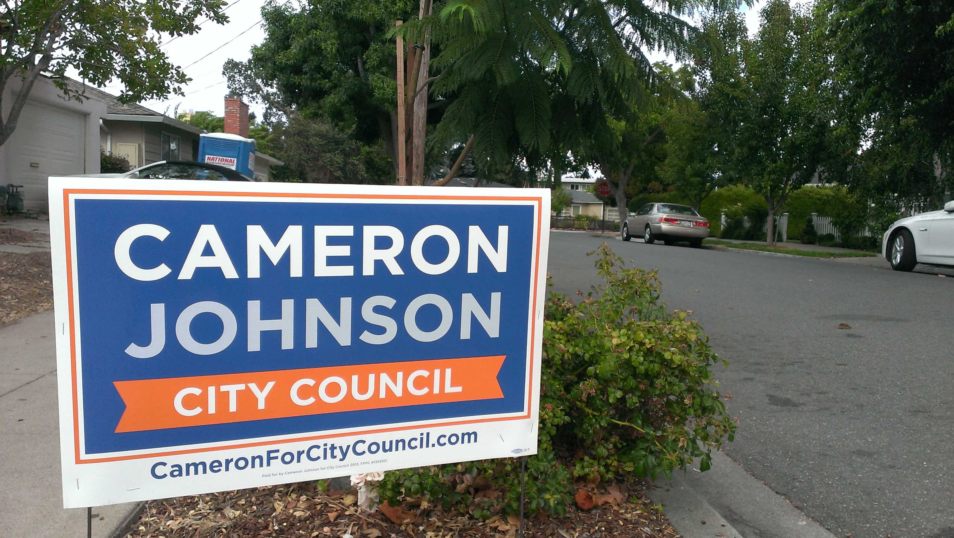 Interns put out lawn signs during the election