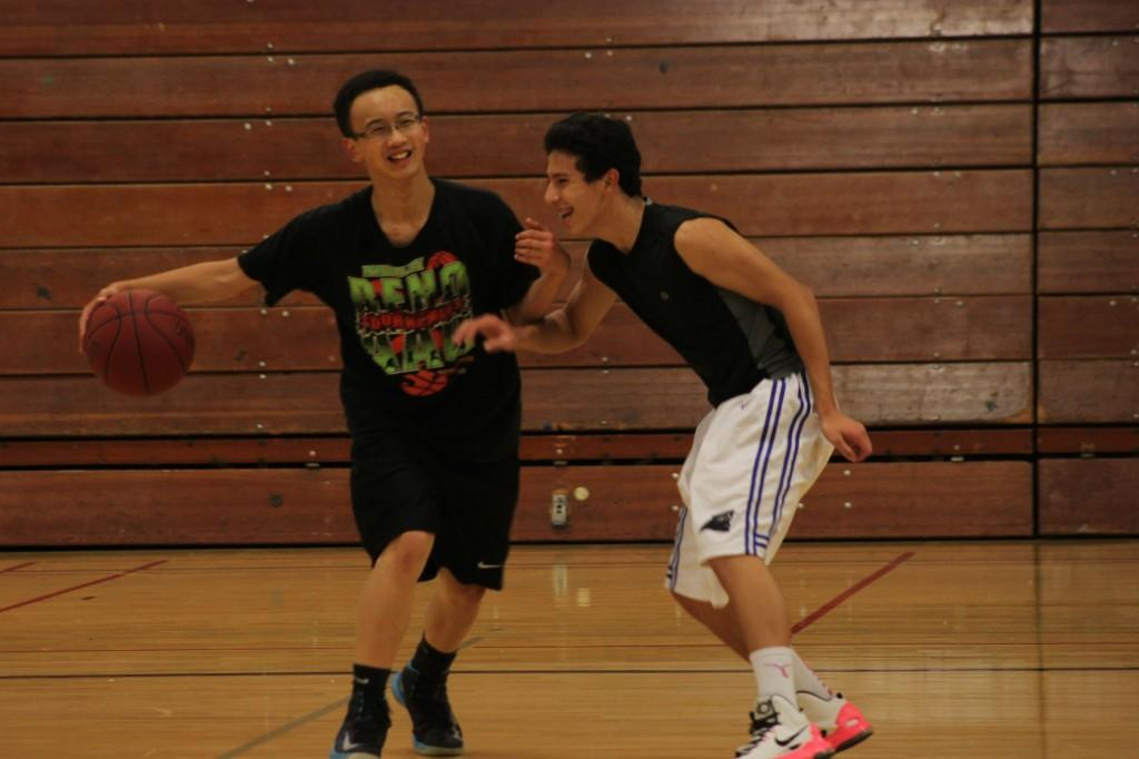 Greg Lau and Spencer Enriquez defend each other on the court