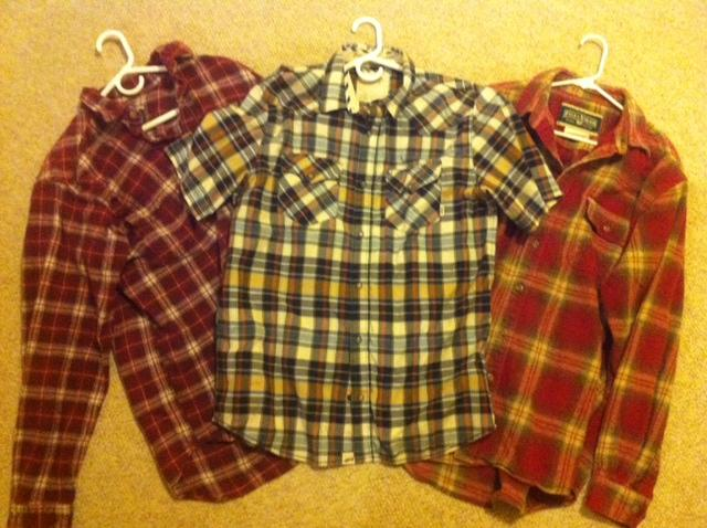 Three flannels laid out in preparation for Flannel Friday