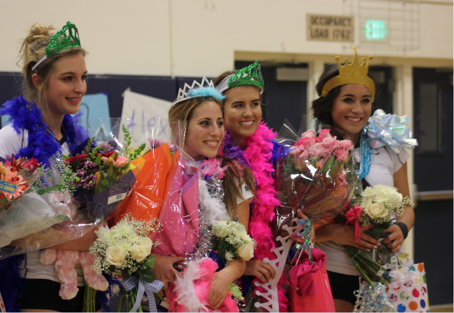 Seniors Kellan McDonough, April Smith, Bailee Roces, and Amelia Tupou smile for their last home game