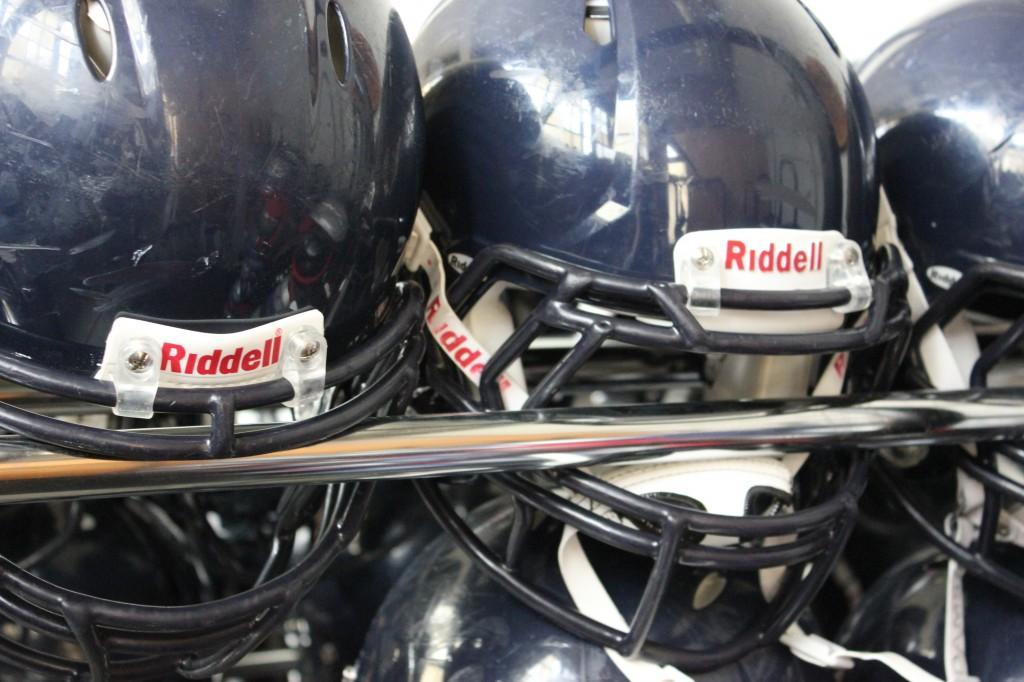 Carlmont%27s+football+team+wears+helmets+to+decrease+the+risk+of+concussions.
