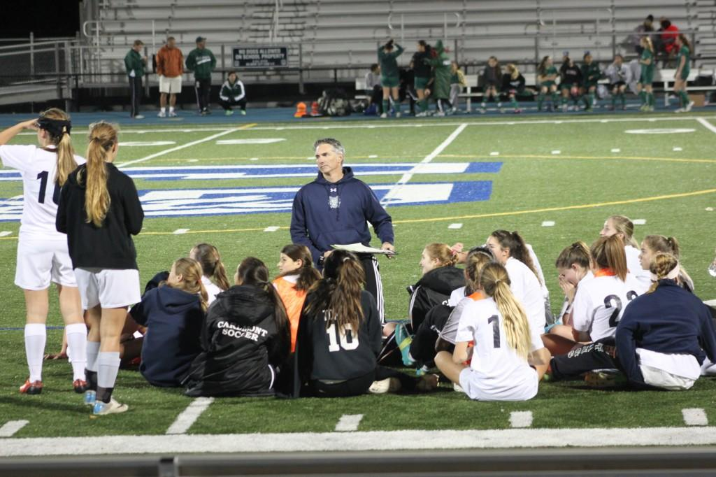 Coach Steve Pendleton addresses his team at halftime during the Lady Scots' tie with Palo Alto High on Dec. 2.