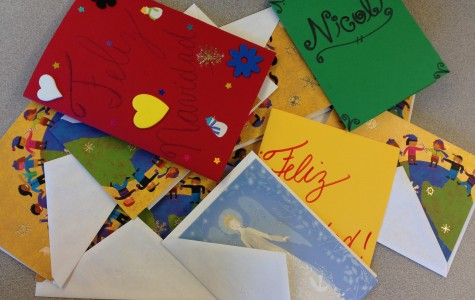 Feminist club makes Christmas cards to send to a safe house in Costa Rica.