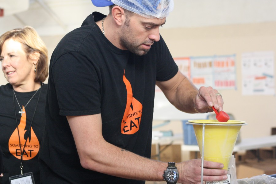Jeremy Affeldt, Giants pitcher along with other volunteers help to prepare meals for families suffering of hunger in the Bay Area and Guatemala through the   organization Something to Eat.