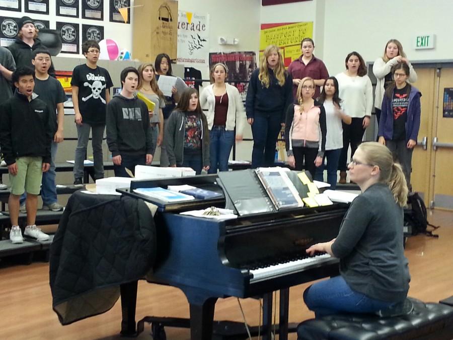 Choir Director Genevieve Tep leads Concert Choir in their warm-ups.
