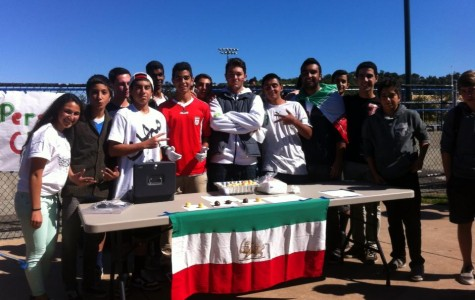 Persian club poses after selling every piece of their food at the clubs fair.