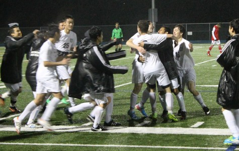 Boys Varsity Soccer runs on the field to congratulate junior Nathan Rosenthal for scoring the winning goal for Carlmont in double-overtime.