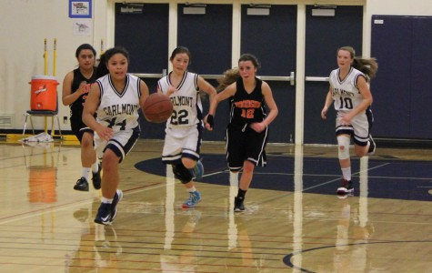 Sophomore Vianka Adamovitch rushes back to her basket after stealing the ball from Woodside High School.