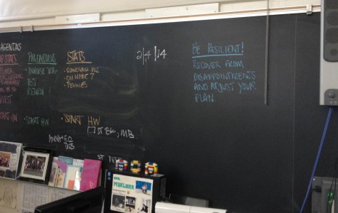 Pearlman's chalkboard full of homework reminders for her three classes.
