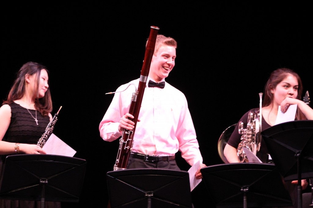 A woodwind quintet including Joyce Ling (left), Franklin Rice (middle), and Christina Galisatus (right) finishes performing The Pink Panther.