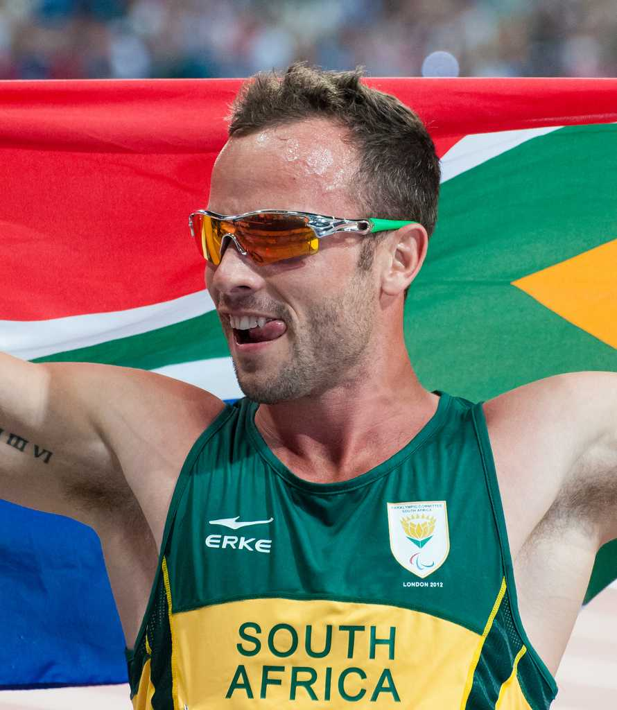 Runner Oscar Pistorius represents his country after a race. Image courtesy of Creative Commons Search.