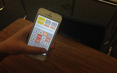 A student plays the new addicting app, 2048.